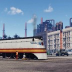Milwaukee 4-4-2 leaving the depot in industrial district
