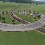 S-Bahn am Kreisverkehr BÜ