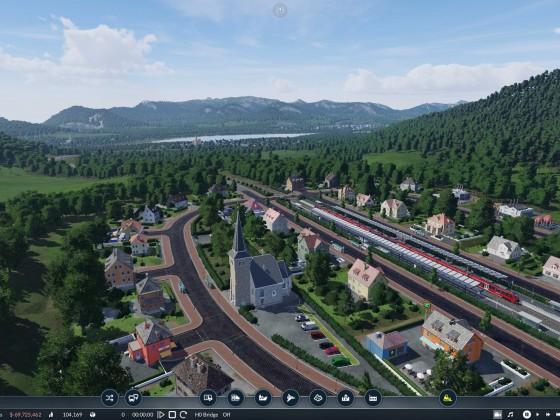 Blick von Dorf auf dem Hügel zum Tal hinunter