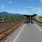 Ein noch unfertiger Bahnhof im ebenfalls unfertigen Gebirge