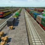 Viele Güter die darauf warten auf Zügen beladen zu werden