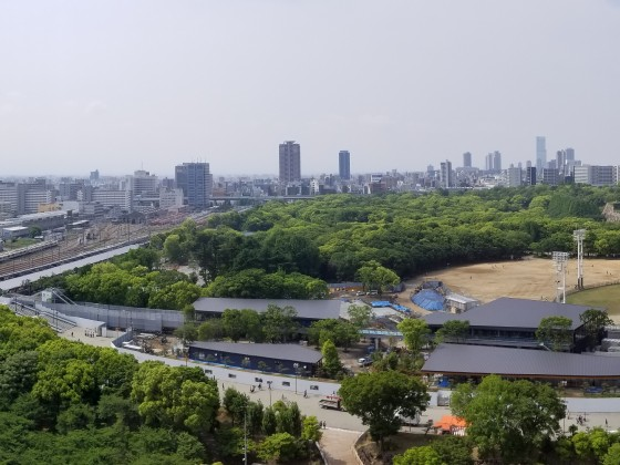 Osakajo Station and JR Osaka Loop depot, with Osaka Castle