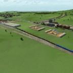 Voll beladener Güterzug bei der Einfahrt in die Container Station