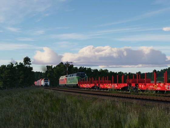 Die zwei V200 der Brohltalbahn warten mit ihrem leeren Stahlzug auf Einfahrt in das Stahlwerk, aus dem der Mitlerweile Leere Erz-/Kohlebomber kommt