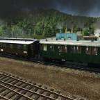 KkstB Schnellzugwagen hinter preussischen Durchgangswagen