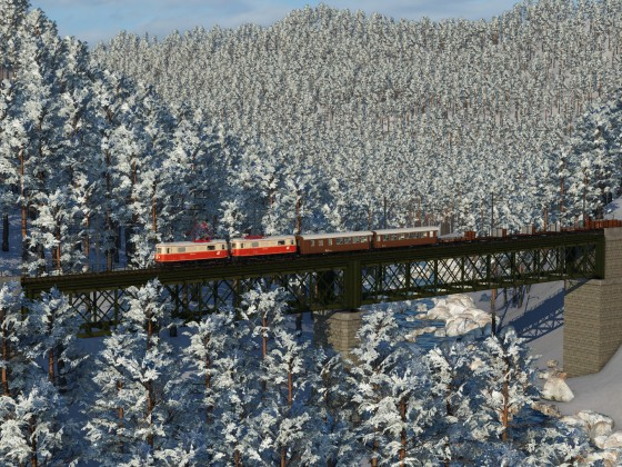 Winter atmosphere in Austria with ÖBB 1099 and mixed train