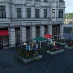 Ein schönes Café am Hafen auf einem kleinen Platz.