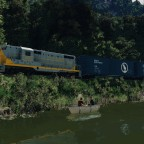 Clinchfield GP7 by the forest river