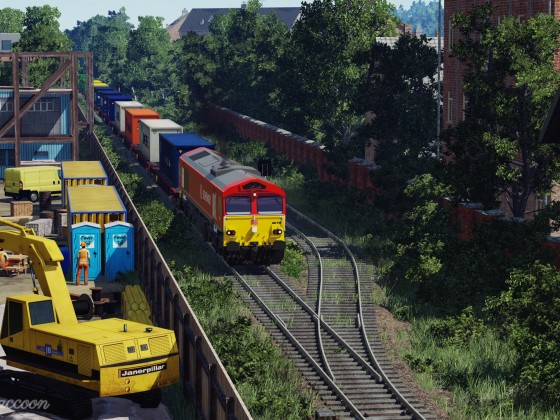 [TpF1] DB BR 66 with containers crossing the city