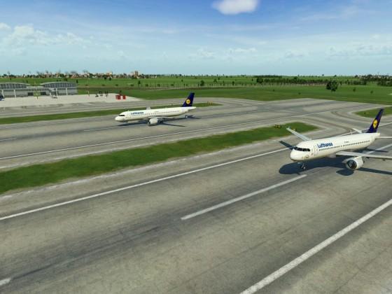 Ein Flugzeug landet, dass andere Startet