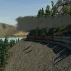 Ein Dampfzug schlängelt sich die Berg hoch