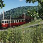 [TpF1] Trainspotting tram near the mountain village