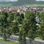 Blick von Osten auf Schulanlage und Grüngürtel